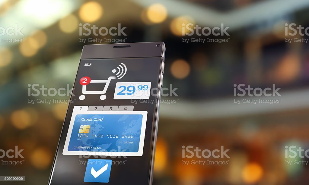 Contactless payment: smartphone detail with shopping cart in retail store stock photo