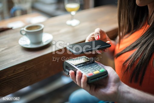 istock Contactless payment system with mobile phone 529051062