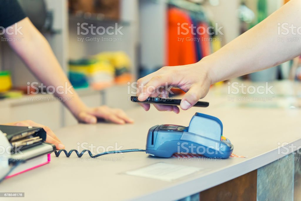 Contactless payment using smart phone stock photo