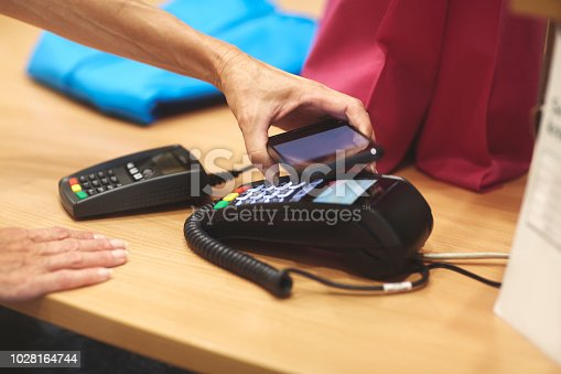 istock Contactless payment with mobile phone 1028164744