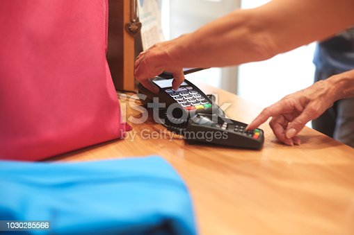 istock Contactless payment with mobile phone 1030285566