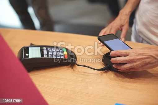 istock Contactless payment with mobile phone 1030817664