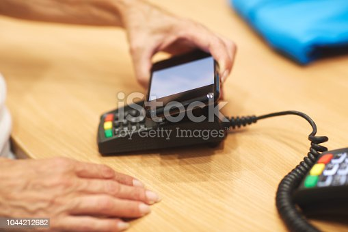 istock Contactless payment with mobile phone 1044212682