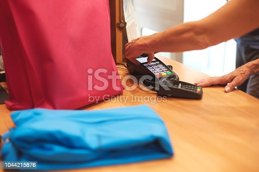 istock Contactless payment with mobile phone 1044215876