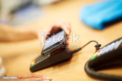 istock Contactless payment with mobile phone 1053416658