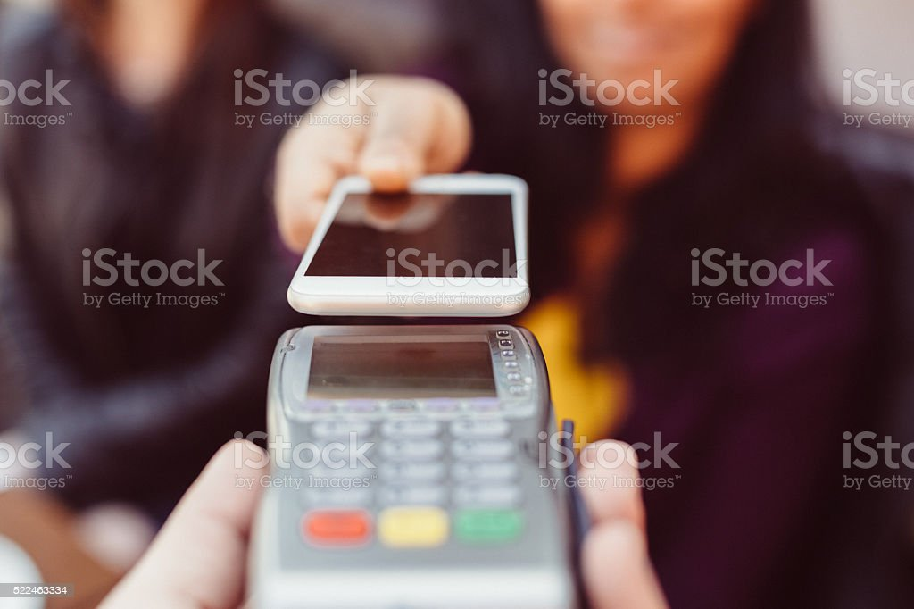 Contactless payment with smartphone in a cafe stock photo