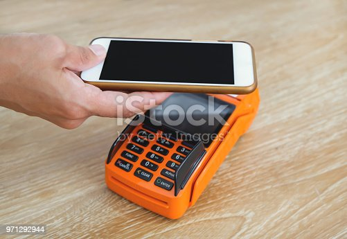 istock Contactless payment with smartphone 971292944