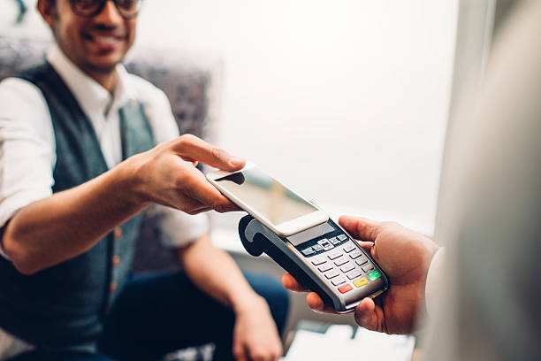 contactless smartphone payment - contactless payment stock pictures, royalty-free photos & images