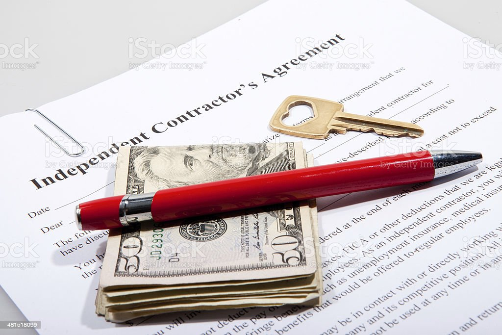 Contactor's agreement with key and Dollar notes stock photo