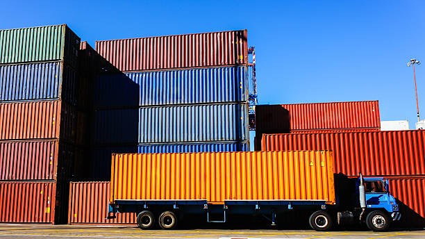 container and truck in the port - lorries unloading stock photos and pictures