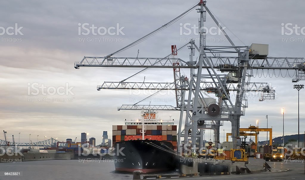 Container boat and cranes at dawn royalty-free stock photo