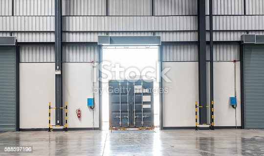 istock Container box on truck at loading dock shipping industry warehouse 588597196