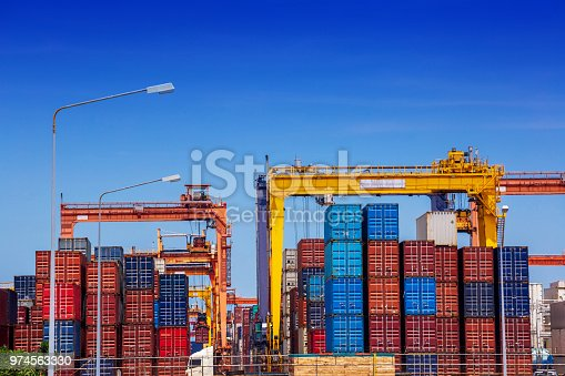 638310484 istock photo container cargo freight ship in container terminal yard is loading in sea port 974563330