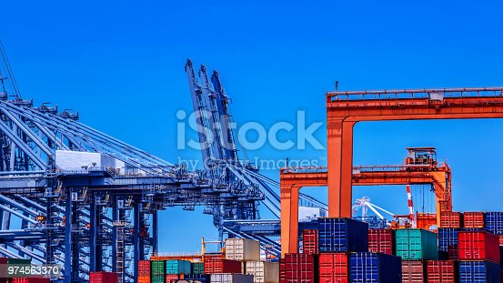 638310484 istock photo container cargo freight ship in container terminal yard is loading in sea port 974563370