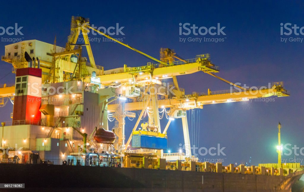 Container Cargo Freight Ship With Working Crane Bridge In