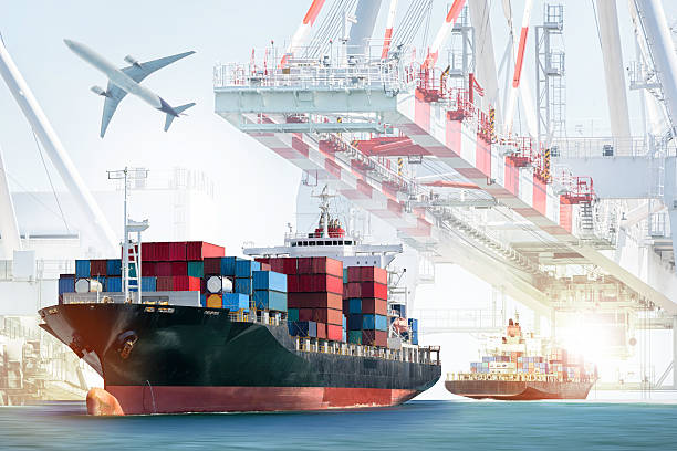 Container Cargo ship and Cargo plane with working crane Container Cargo ship and Cargo plane with working crane bridge in shipyard background, logistic import export background and transport industry. customs official stock pictures, royalty-free photos & images