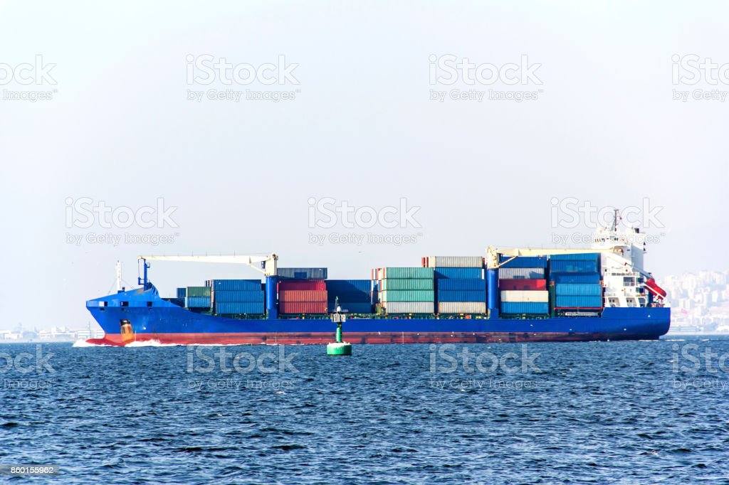 Container Cargo Ship At The Sea stock photo