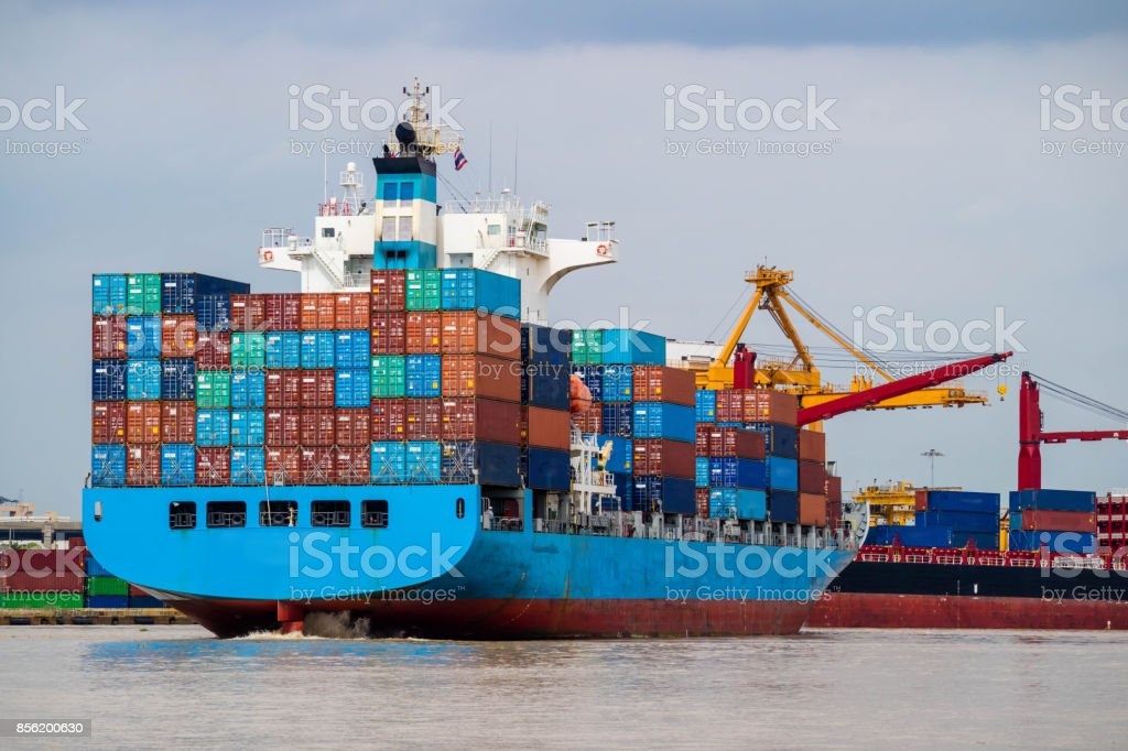 Container cargo ship depart from shipping port. Logistics industrial and import export transportation business background stock photo