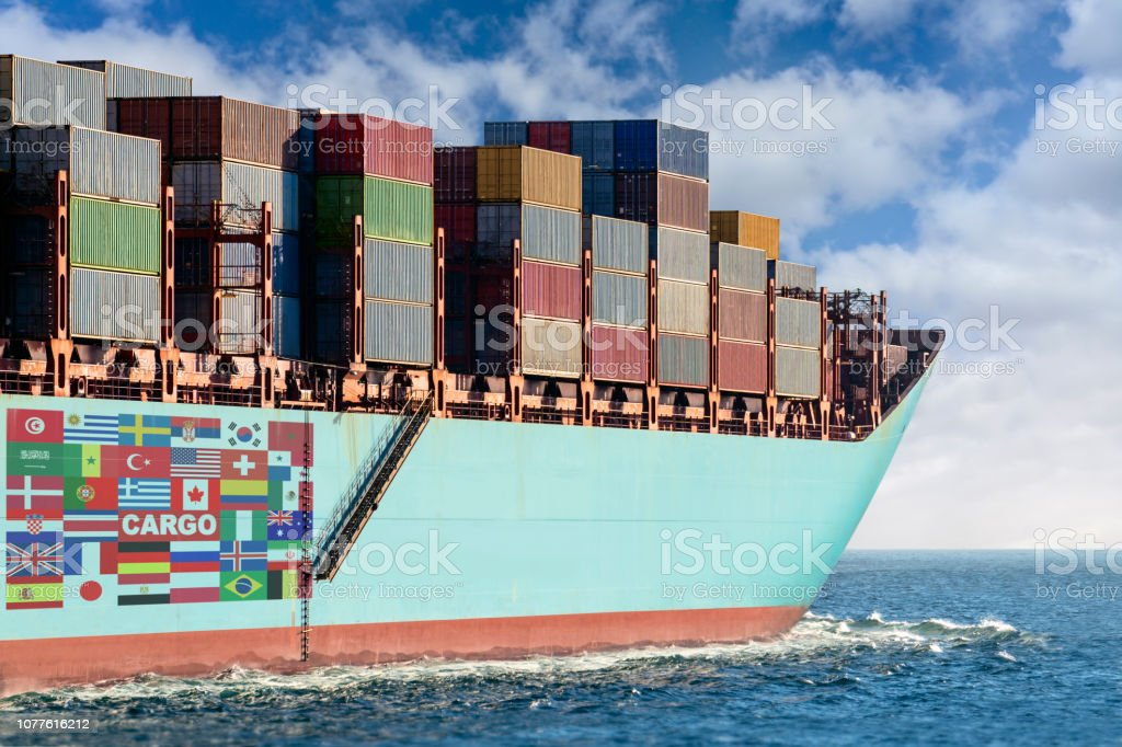 Container Cargo ship in the ocean.