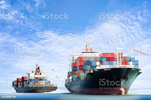 Container cargo ship in the ocean with birds flying picture id543988758?b=1&k=6&m=543988758&s=612x612&h=oqx2j cj8grjycbybzr4trz4lmvyqy5wtl1olfieor8=