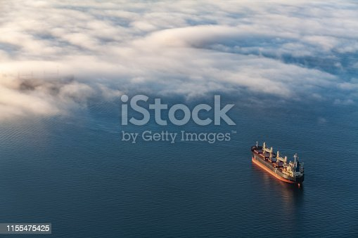 istock Container cargo ship in Vancouver's English Bay 1155475425