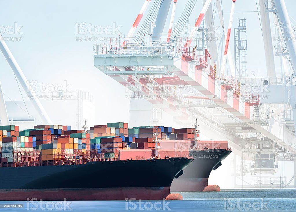 Container Cargo Ship with working crane bridge in shipyard background stock photo