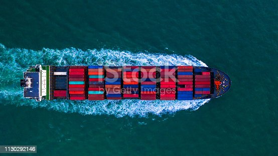 istock Container freight ship carrying container box for import and export business logistic and transportation by container ship in open sea, Aerial view. 1130292146