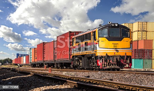 istock Container Freight Train with cloudy sky. 959775388