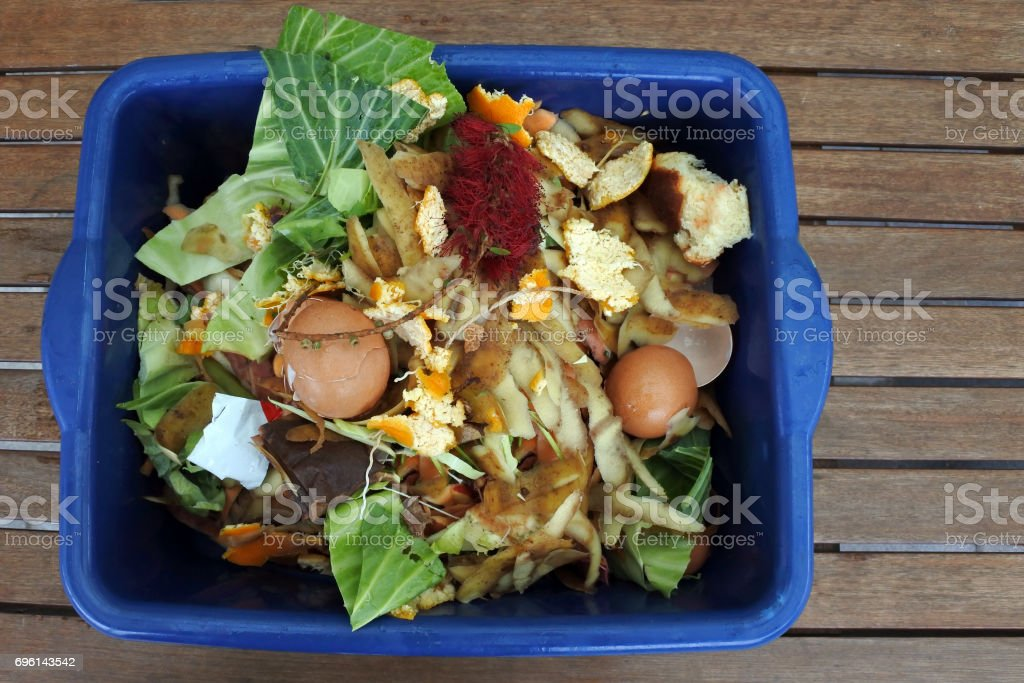 Container full of domestic food waste stock photo