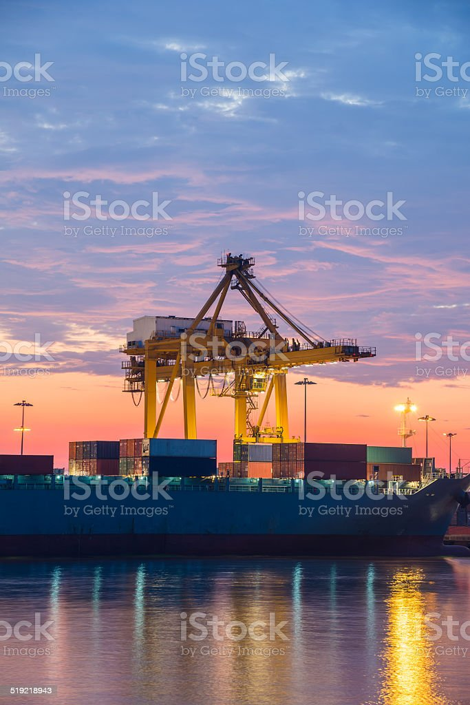 Container harbour at sunrise stock photo