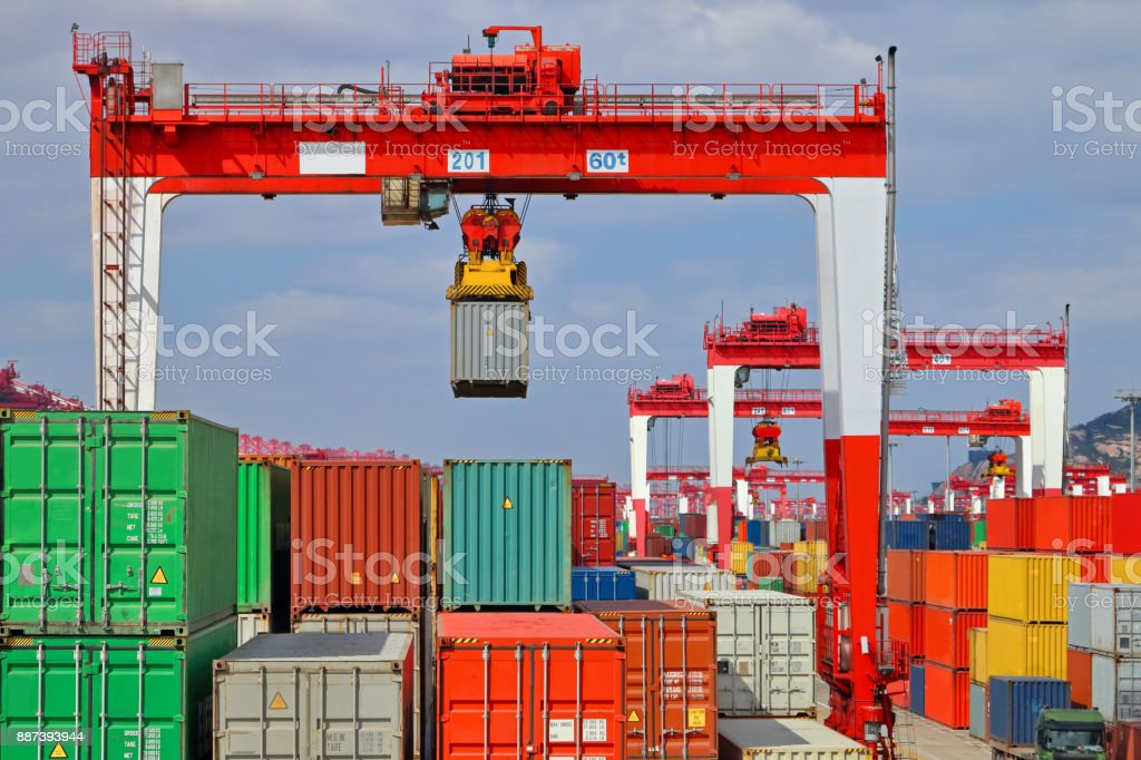 Container lifted by crane stock photo