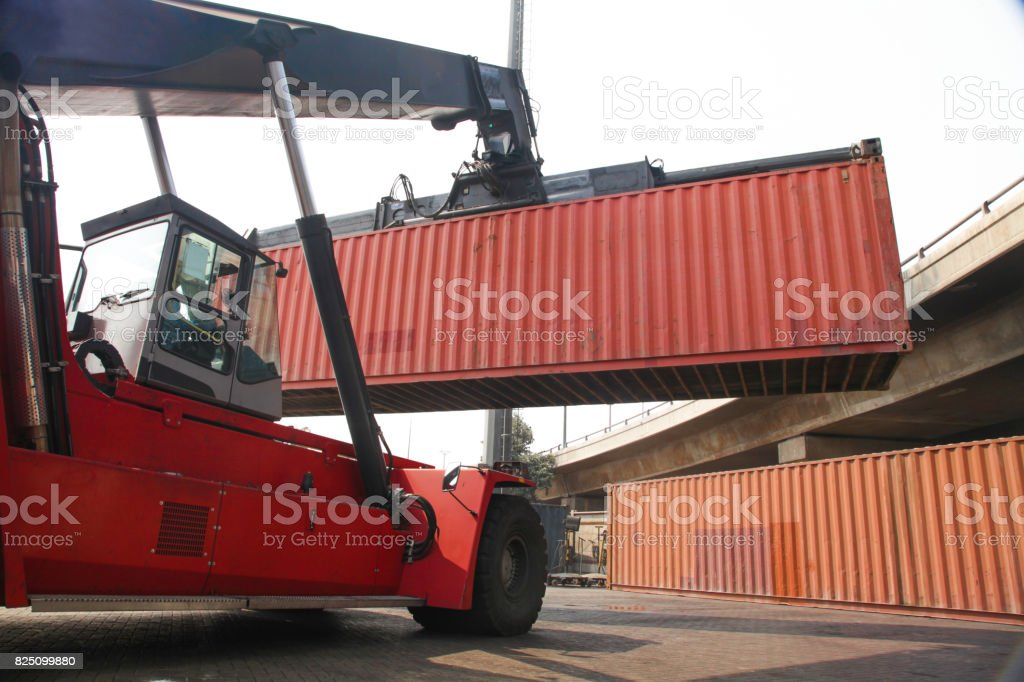 Container lifting lodging fork lifter stock photo