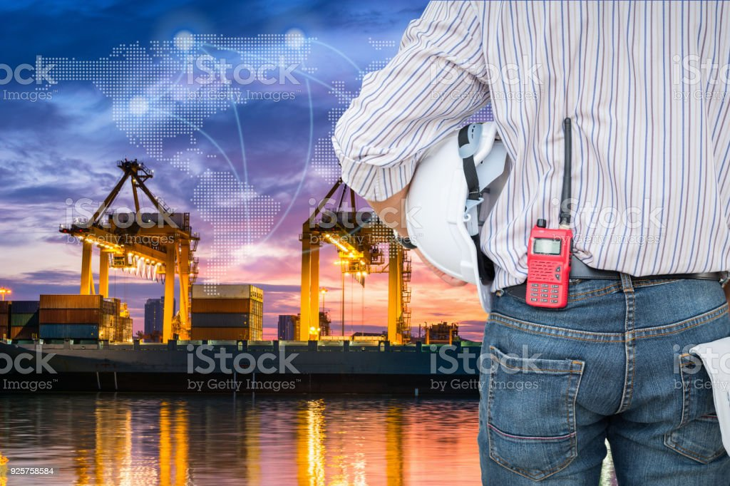 Container loading terminal and shipping dock with world map conncection stock photo
