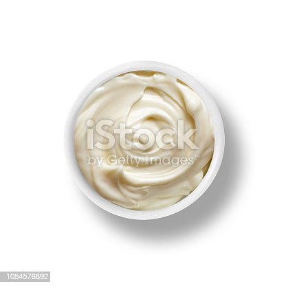A small bowl of Mayonnaise isolated on a white background top down view from above