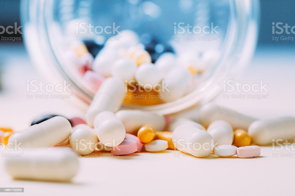 Container of Pills tablets and capsules stock photo
