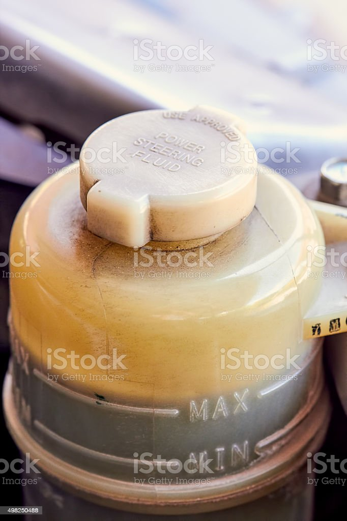 Container of power steering fluid for car royalty-free stock photo