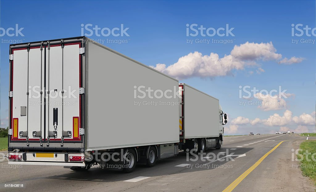 Container on the big highway. transport loads stock photo