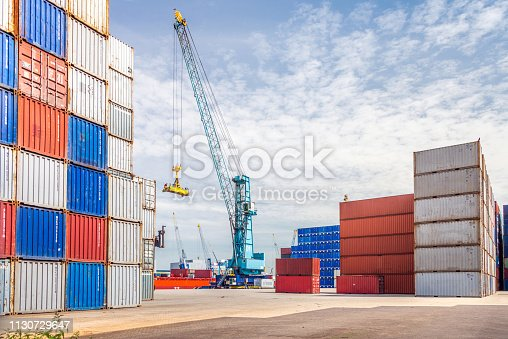637816284istockphoto Container port with crane, Rotterdam, Holland 1130729647