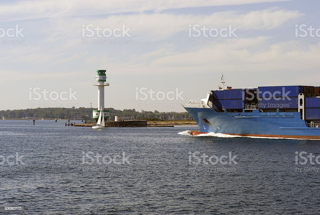 Container ship and lighthouse royalty-free stock photo