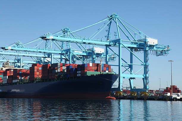 Container ship at commercial dock stock photo