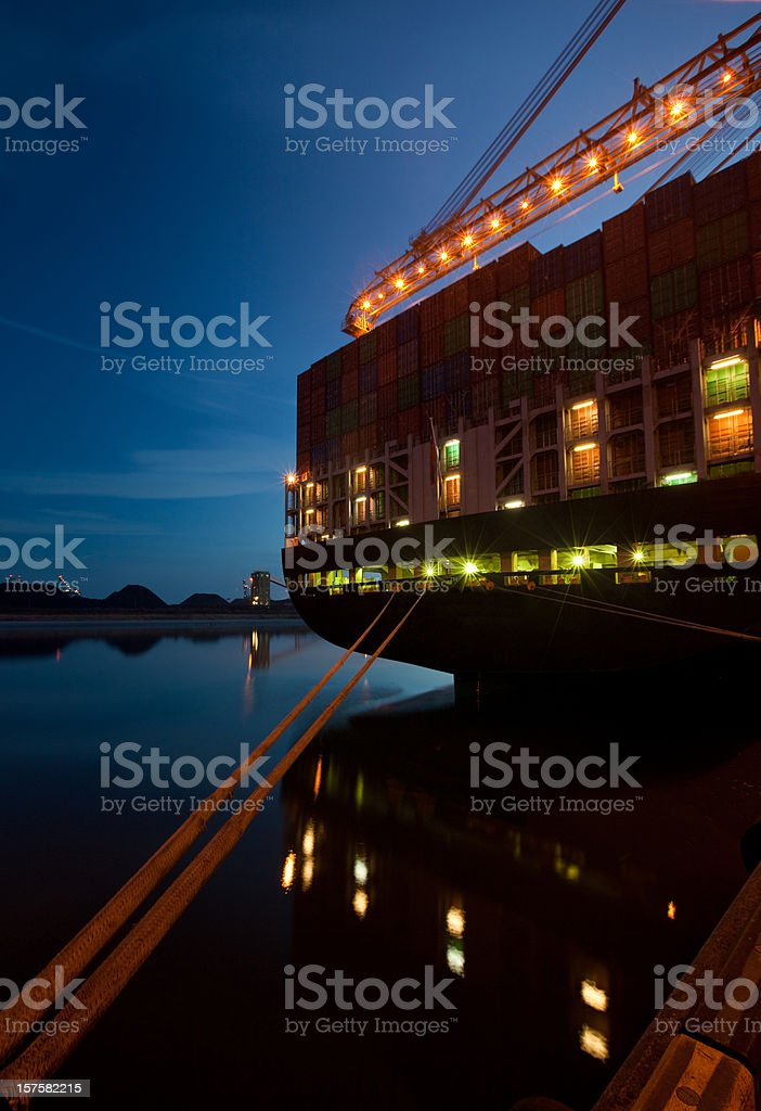 Container ship at dusk royalty-free stock photo