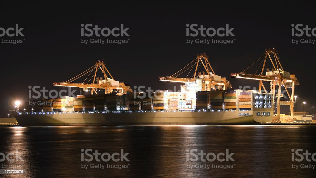 Container ship at night royalty-free stock photo