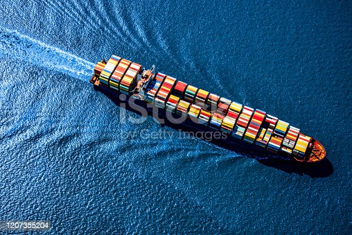 A fully loaded container ship heading toward the Port of Houston, Texas from the Gulf of Mexico.