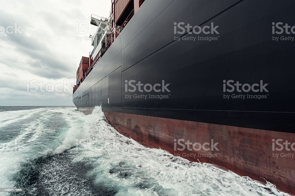 A 200m long container ship navigates the North Atlantic under...