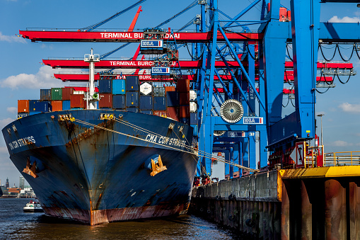 Container ship being loaded in Hamburg Harbour, Germany.