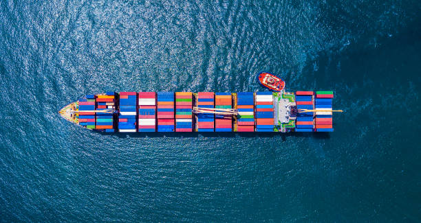 Container Ship Cargo Container Ship from the sky. container ship stock pictures, royalty-free photos & images