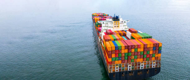 Container ship carrying container, Business shipping import and export logistic and transportation of international by container ship in the open sea. stock photo
