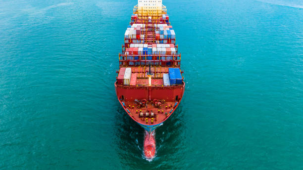 Container ship carrying container for import and export, Aerial view business logistic and freight transportation by ship in open sea. Container ship carrying container for import and export, Aerial view business logistic and freight transportation by ship in open sea. container ship stock pictures, royalty-free photos & images