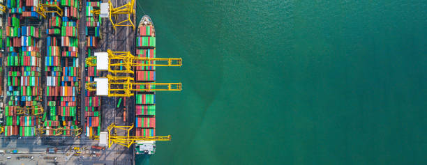 Container ship carrying container for import and export, business logistic and transportation by ship in open sea, Aerial view container ship with copy space. stock photo