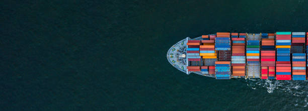 Container ship carrying container for import and export, business logistic and transportation by container ship in open sea, Aerial view container ship with copy space for design banner web stock photo